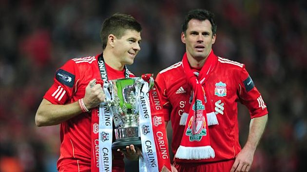 Liverpool's Steven Gerrard (left) and Jamie Carragher (right) celebrate with the Carling Cup Trophy