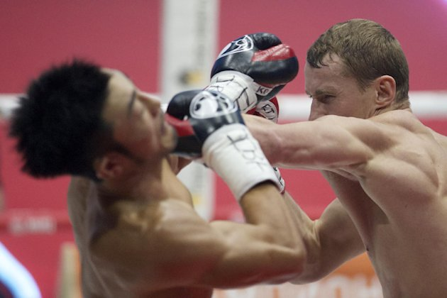 Russia's Eduard Troyanovsky, right, and Japan's Keita Obara battle during their IBF and IBO light welterweight title bout in Moscow, Russia, on Friday, Sept. 9, 2016. Troyanovsky defended his title. (AP Photo/Ivan Sekretarev)