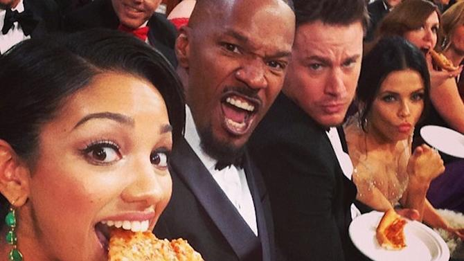 Please Enjoy These Photos of Celebrities Eating Pizza in Ball Gowns