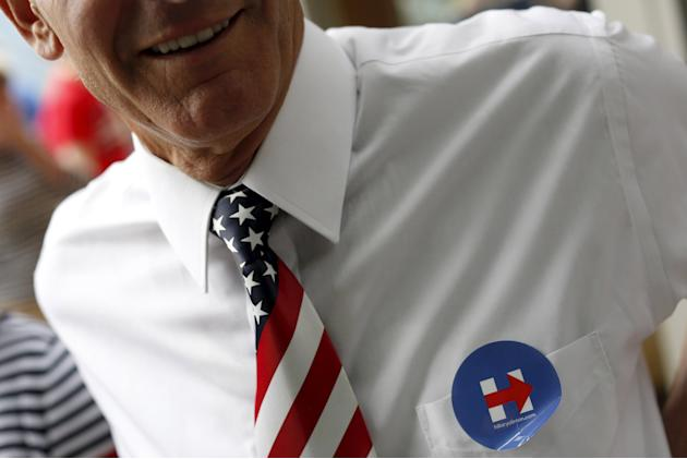A supporter of former United States Secretary of State and Democratic presidential candidate Hillary Clinton sports a U.S. flag tie and a campaign sticker during a Fourth of July event in Glen, New Ha