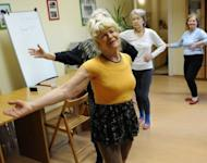 """Ludwika Kochman, a volunteer of the """"Little Brothers of the Poor"""" association which supports seniors citizens, leads a gym session in Poznan, Poland, on March 5"""