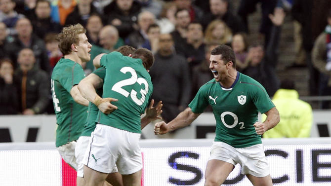 Ireland's rugby team players celebrate defeating France and winning the Six Nations Rugby Union tournament at the Stade de France stadium, in Saint Denis, outside Paris, Saturday, March 15, 2014. (AP Photo/Christophe Ena)