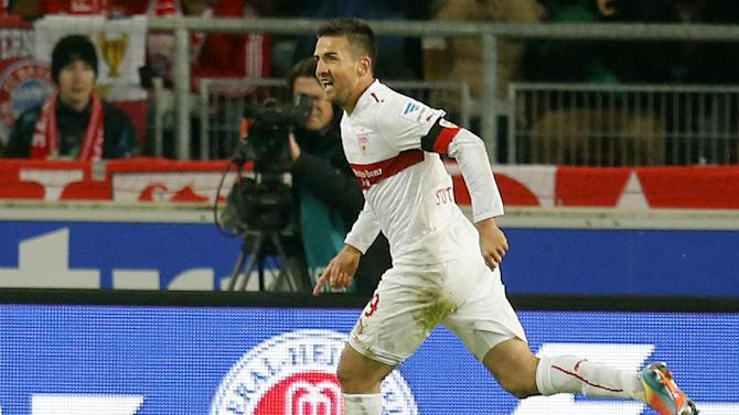 Stuttgart's Vedad Ibisevic of Bosnia celebrates his side's opening goal during a German first soccer division Bundesliga match between VfB Stuttgart and FC Bayern Munich in Stuttgart, Germany, Wednesday, Jan. 29, 2014