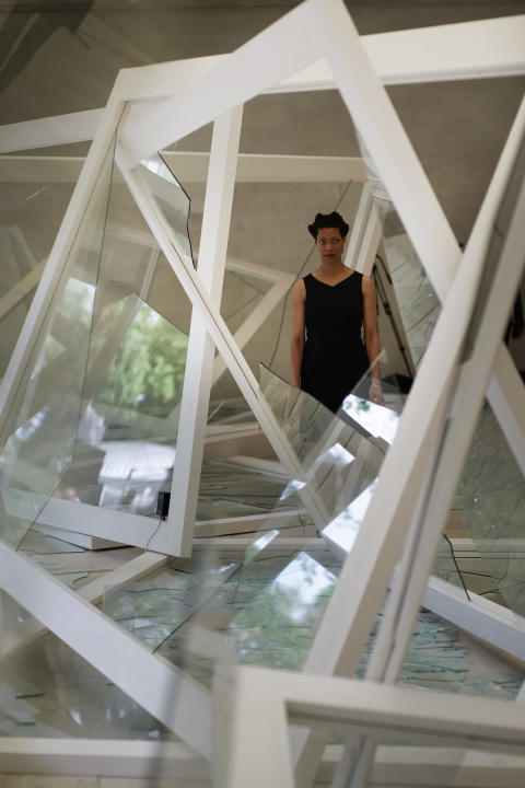 Artist Camille Norment poses at the Nordic Pavilion next to her installation 'Rapture' at the 2015 Biennale of Arts in Venice, Italy, Wednesday, May 6, 2015. (AP Photo/Domenico Stinellis)