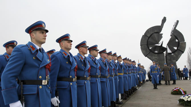 A Serbian military honor guard stand to attention during commemorations for victims of the Holocaust at a monument erected in the former World War II Nazi concentration camp of Sajmiste in Belgrade, Serbia, Sunday, Jan. 27, 2013. The ceremony coincided with International Holocaust Remembrance Day, which marks the liberation of the Auschwitz Nazi concentration camp on Jan. 27, 1945. (AP Photo/Darko Vojinovic)