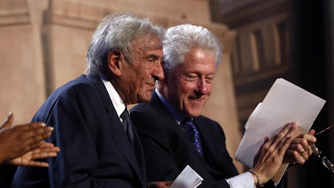 Former President Bill Clinton and Nobel Peace Prize laureate Elie Wiesel participate in an event for the 20th anniversary of the United States Holocaust Memorial Museum in Washington, Monday, April 29, 2013. (AP Photo/Charles Dharapak)