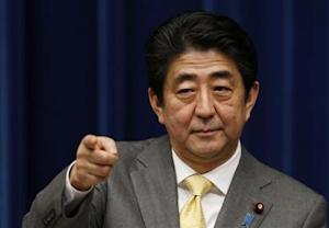 Japan's Prime Minister Shinzo Abe points to a reporter during a news conference at his official residence in Tokyo