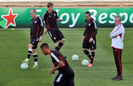Bayern Munich coach Jupp Heynckes (right) looks at his players during a training session in Marseille