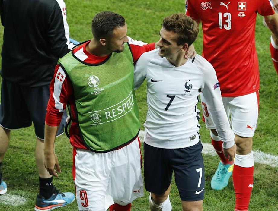 France's Antoine Griezmann and Switzerland's Haris Seferovic at half time