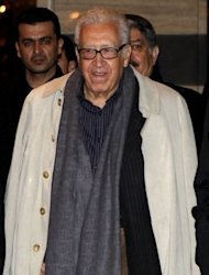 Lakhdar Brahimi arrives at his hotel in the Syrian capital Damascus on Sunday. Officials said the UN-Arab League envoy, seen at the Sheraton Hotel in central Damascus, travelled overland from neighbouring Lebanon on a previously unannounced visit.