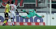 Augsburg's goalkeeper Simon Jentzsch (R) saves the ball during their German first division Bundesliga match vs Borussia Dortmund, in Augsburg, southern Germany, on March 10. Augsburg play Bayern Munich next, at Allianz Arena, on Saturday