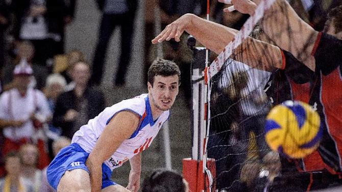 Milos Nikic from Serbia, smashes a ball during a playoff match against Denmark in the Volleyball European Championship in Aarhus, Denmark, Tuesday Sept. 24, 2013