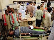 Pakistanis, injured during shooting in Karachi, lie on hospital stretchers at a hospital in the city. Violence between ethnic groups and criminal gangs killed 39 people in Pakistan's financial capital of Karachi, police said Thursday, as the government again struggled for solutions to the unrest