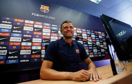 FC Barcelona's soccer coach Luis Enrique attends a news conference at Joan Gamper training camp