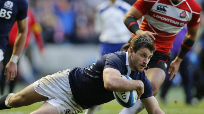 Scotland's Tommy Seymour scores a try against Japan during their rugby union match at Murrayfield Stadium in Edinburgh