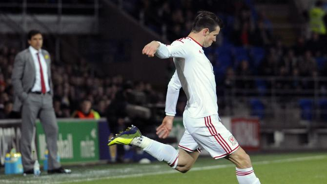 Wales' Gareth Bale takes a free kick against Iceland during the friendly international soccer match at Cardiff City Stadium in Cardiff