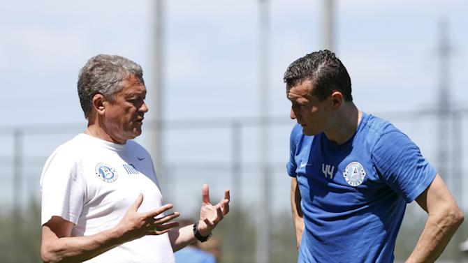 Dnipro's coach Markevych speaks to Fedetskiy during training session at team's training camp in Dnipropetrovsk