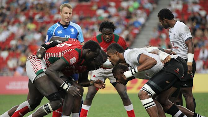 Fiji and Kenya contest a scrum during the Cup Final