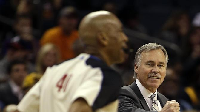 Los Angeles lakers coach Mike D'Antoni, right, tries to get the referee's attention during the first half of an NBA basketball game against the Charlotte Bobcats in Charlotte, N.C., Saturday, Dec. 14, 2013