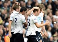 Tottenham Hotspur's Christian Eriksen (R) and Gylfi Sigurdsson (L) are both congratulated by team mates after Sigurdsson scored a goal during their English Premier League soccer match against Norwich City at White Hart Lane in London September 14, 2013. REUTERS/Dylan Martinez