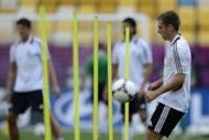 Germany open their Euro 2012 campaign bidding to beat Portugal for the third successive time at a major finals with captain Philipp Lahm, seen here at a training session on June 8, insisting his team must show what they can do on Saturday