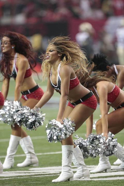Atlanta Falcons cheerleaders perform during the second half of an NFL football game against the New Orleans Saints, Sunday, Sept. 7, 2014, in Atlanta. (AP Photo/John Bazemore)