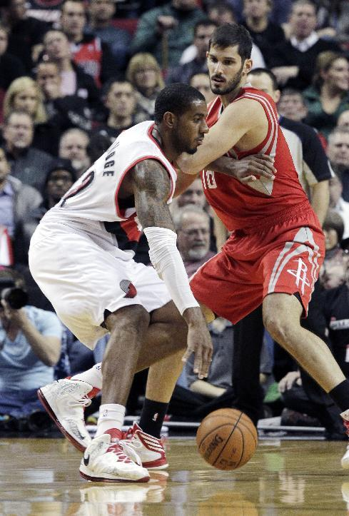 Portland Trail Blazers forward LaMarcus Aldridge, left, drives on Houston rockets forward Omri Casspi, from Israel, during the first half of an NBA basketball game in Portland, Ore., Tuesday, Nov. 5, 2013