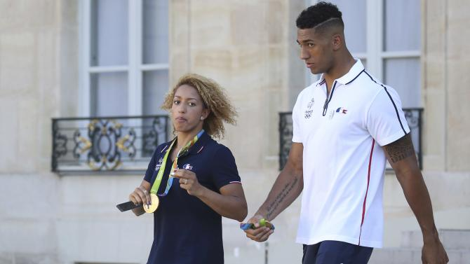 French Olympic boxing champions Yoka and Mossely leave the Elysee Palace in Paris