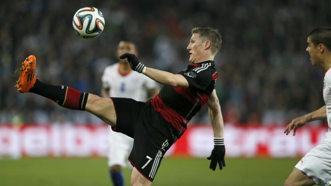 Germany's Schweinsteiger controls ball in front of Chile's Silva during their international soccer friendly match in Stuttgart