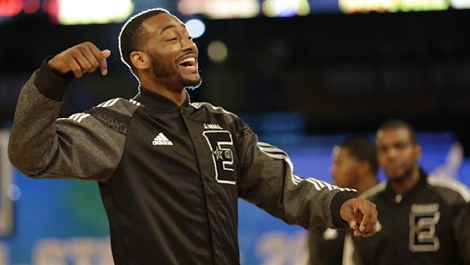 East Team's John Wall, of the Washington Wizards walks the floor before the NBA All Star basketball game, Sunday, Feb. 16, 2014, in New Orleans