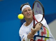 Argentina's David Nalbandian returns the ball to Bulgaria's Grigor Dimitrov during their semi-final match at the Queen's Club in west London. Nalbandian won 6-4, 6-4