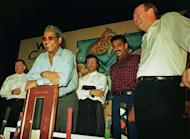 Cricketing greats Ian Chappell (L), Sir Gary Sobers (leaning on plaque), Asif Iqbal (centre back), Ravi Shastri (2nd R) and Tony Greig at a cricket memorabila auction at a hotel in south Bombay on May 16, 1997. Flamboyant former England cricket captain and television commentator Greig died of a heart attack on Saturday at the age of 66, as he battled lung cancer