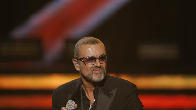 British singer George Michael performs at a concert to raise money for AIDS charity Sidaction, during the Symphonica tour at Palais Garnier Opera house in Paris, France, Sunday, Sept. 9, 2012. (AP Photo/Francois Mori)