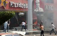 "Lebanese men ransack US fast food chains Hardee's and KFC as they protest against the controversial film ""Innocence of Muslims"" in the northern Lebanese city of Tripoli"