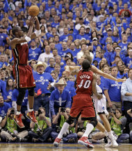 Miami Heat's Chris Bosh takes a shot in the final minute of the second half of Game 3 of the NBA Finals basketball game against the Dallas Mavericks Sunday, June 5, 2011, in Dallas. The Heat won 88-86 to take a 2-1 lead in the series.