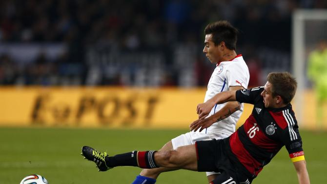Germany's Lahm challenges Chile's Vargas during their international friendly soccer match in Stuttgart