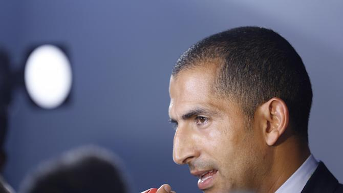 Ivory Coast head coach Sabri Lamouchi from France answers journalists' questions after  the draw ceremony for the 2014 soccer World Cup in Costa do Sauipe near Salvador, Brazil, Friday, Dec. 6, 2013