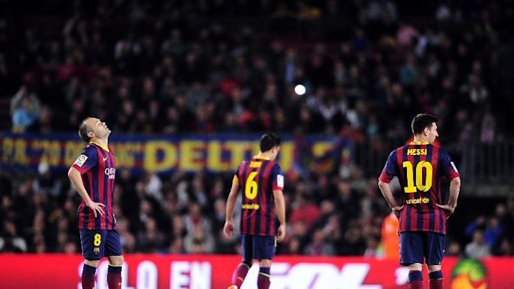 FC Barcelona's Andres Iniesta, left, Xavi Hernandez, center, and Lionel Messi, from Argentina react after Athletic Bilbao scored during a Spanish La Liga soccer match at the Camp Nou stadium in Barcelona, Spain, Sunday April 20, 2014