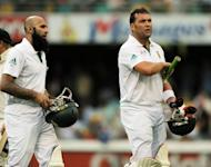Hashim Amla (left) and Jacques Kallis (right) became South Africa's greatest scoring partnership as the Proteas dominated Australia's bowlers to seize control on day one of the first Brisbane Test on Friday