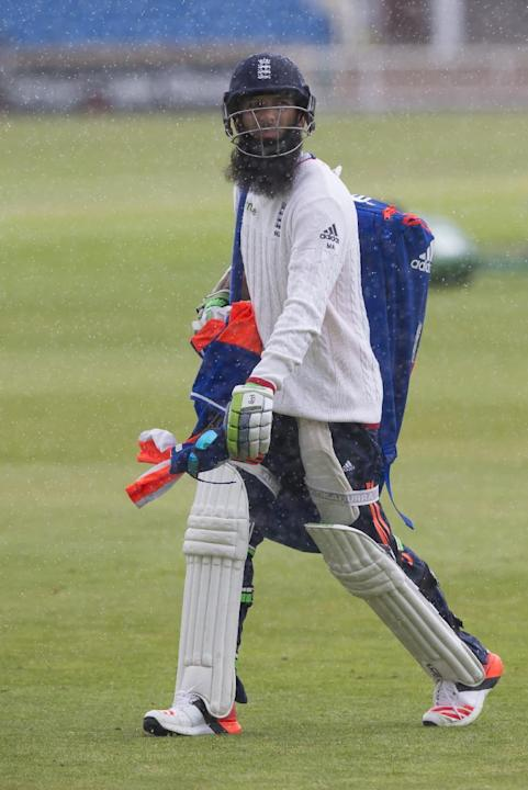 England's Moeen Ali makes his way back to the pavilion during a rain shower at nets the day before the second Test match between England and New Zealand at Headingley cricket ground in Leeds, Engl
