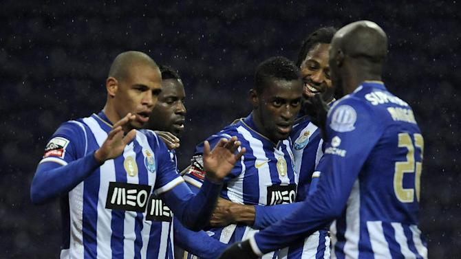 FC Porto's Jackson Martinez, from Colombia, celebrates with Fernando Reges from Brazil, Silvestre Varela, Abdloulaye Ba from Senegal and Eliaquim Mangala from France, from left to right, after scoring his side's second goal against Pacos Ferreira in a Portuguese League soccer match at the Dragao stadium in Porto, Portugal, Sunday, Feb. 9, 2014. Jackson scored once in Porto's 3-0 victory