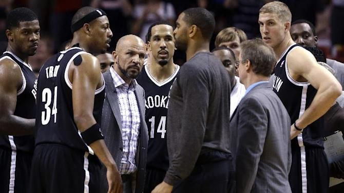 Brooklyn Nets head coach Jason Kidd, center, huddles with players during a timeout in the second half of an NBA basketball game against the Miami Heat, Wednesday, March 12, 2014 in Miami. The Nets defeated the Heat 96-95