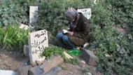 A Syrian woman mourns the death of a relative at a grave in the city of Rastan, just north of the central resitive city of Homs, on April 19. The United Nations Security Council unanimously agreed in a vote on Saturday to send 300 observers to Syria to monitor a shaky ceasefire as UN monitors visited the restive province of Homs