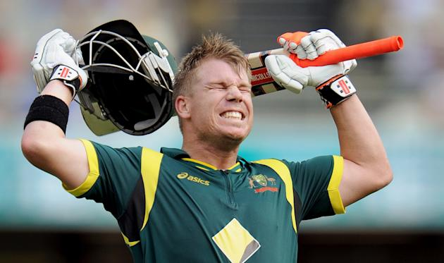 Australian batsman David Warner celebrates his century against Sri Lanka in the first international one-day cricket final at the Gabba in Brisbane on March 4, 2012.  IMAGE STRICTLY RESTRICTED TO EDITO
