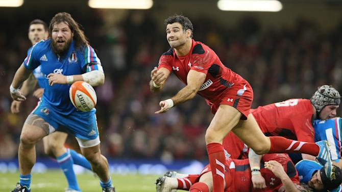 Wales's Mike Phillips passes the ball out from a scrum during their Six Nations international rugby union match between Wales and Italy at the Millennium stadium in Cardiff, Wales, Saturday, Feb. 1, 2014. (AP Photo/Alastair Grant)