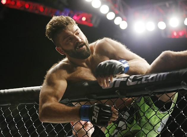 Andrei Arlovski celebrates after defeating Travis Browne in their heavyweight mixed martial arts bout at UFC 187 on Saturday, May 23, 2015, in Las Vegas. (AP Photo/John Locher)