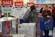Black Friday shoppers inspect goods at a Toys-R-Us store on Black Friday 2011 in Fairfax, Virginia