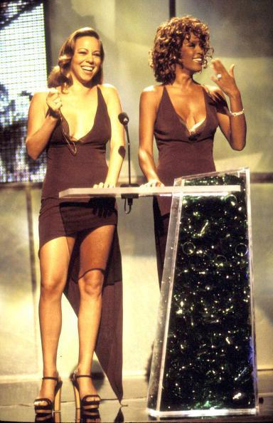 Mariah Carey and Whitney Houston present an award at the 1998 MTV Video Music Awards at the Universal Amphitheatre in Los Angeles, California (Photo by Kevin Mazur/WireImage)