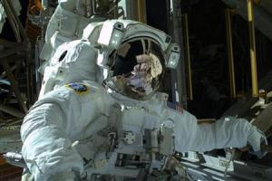 NASA astronaut Mike Hopkins is seen during the spacewalk in this photo courtesy of NASA