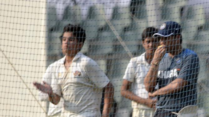 Son of Sachin Tendulkar Arjun bowls during Indian teams practice session ahead of 2nd Test match against West Indies at Wankhede stadium in Mumbai on Nov.12, 2013. (Photo: Sandeep Mahankaal/IANS)
